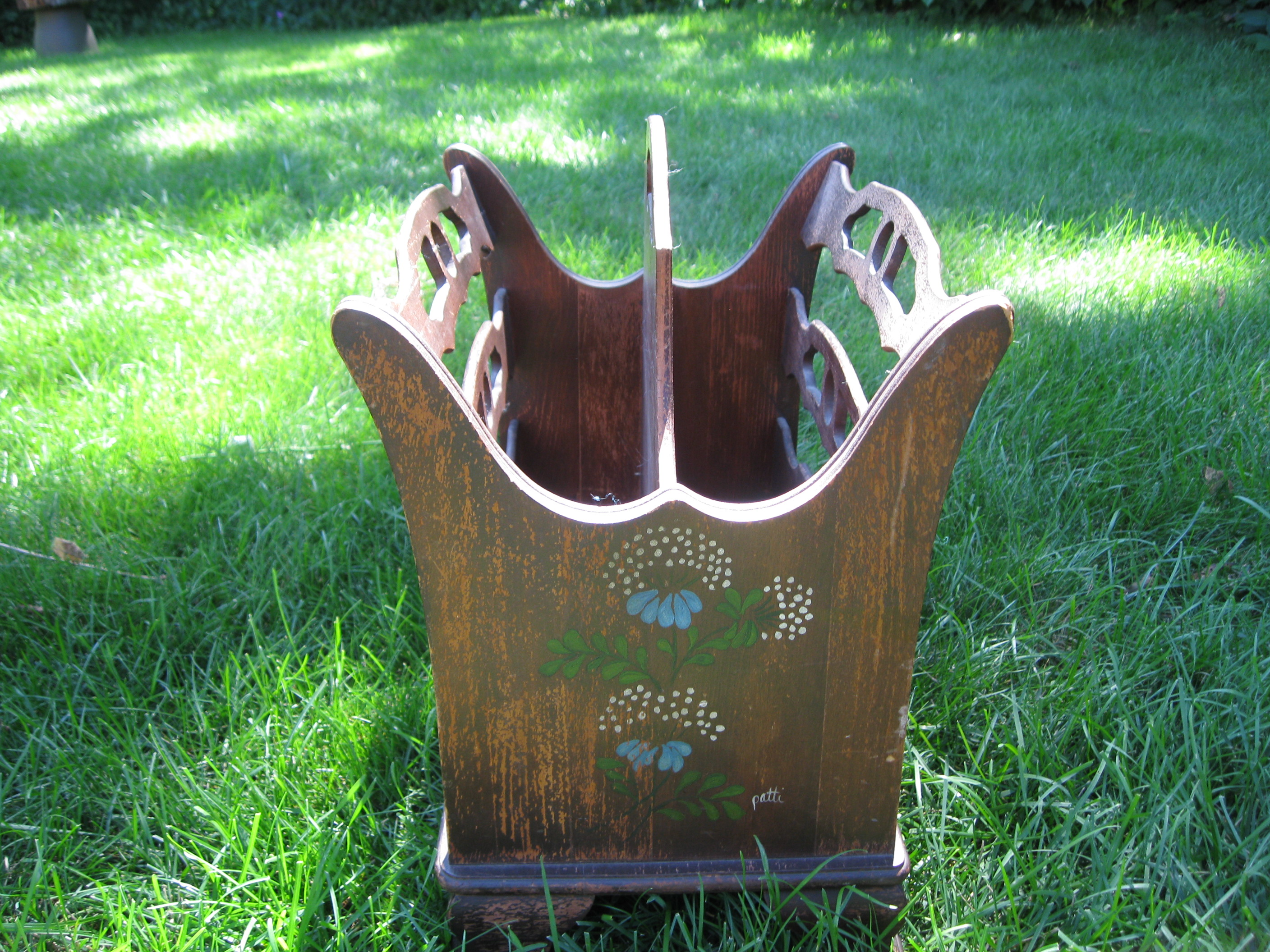 The old magazine rack was a family piece, but worn and water stained