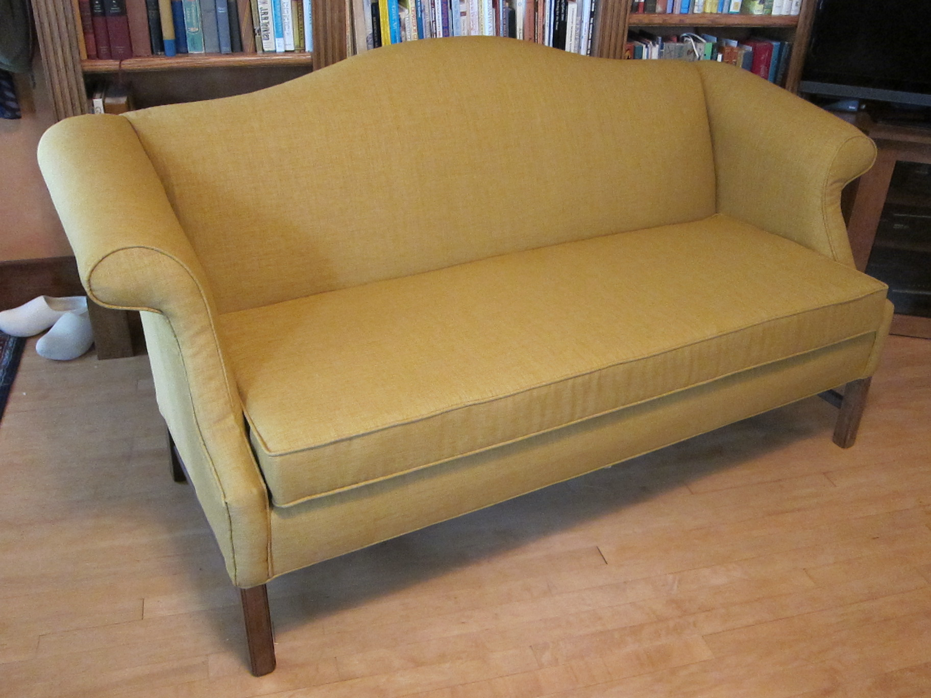 With a bright new cover this favorite sofa is ready to take a place of prominence in the home