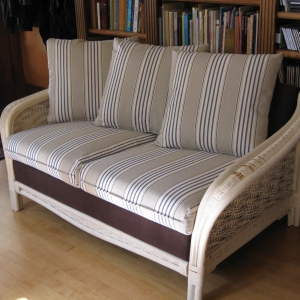 Fun new fabric and repairs to the wicker frame (not shown here) give new life to this lovely loveseat