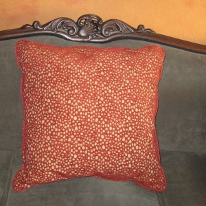 This little pillow matches the stool, thereby pulling the whole room together