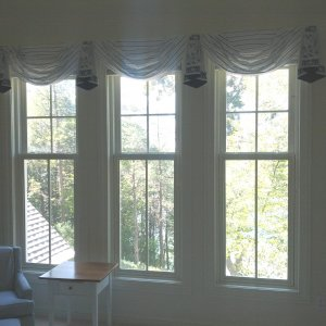 Minimal window treatments show off the beauty of the lake view, while hiding the mini blinds