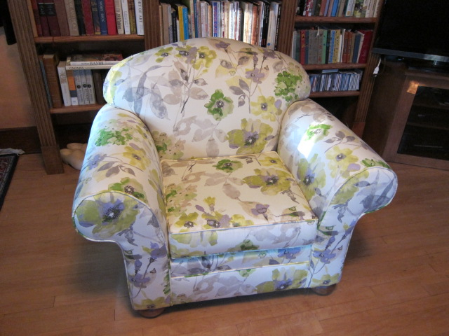 With a whimsical watercolor floral, this chair is ready for a new generation of book sharing
