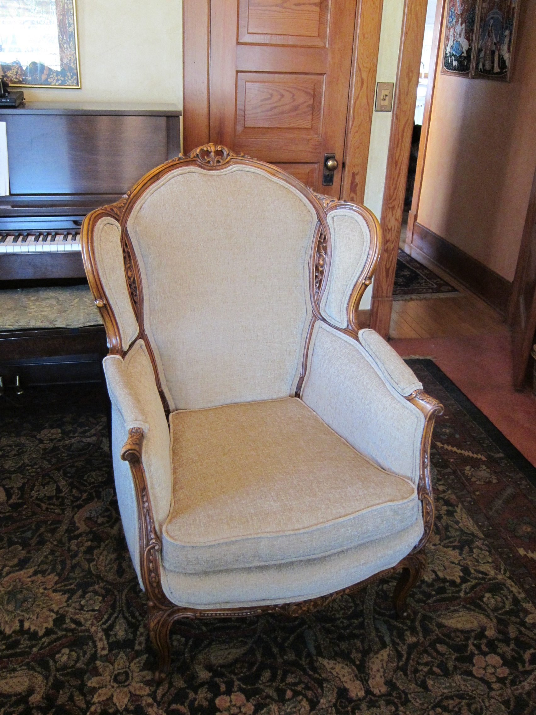 Due to allergies, this chair was torn down to the wood frame and rebuilt with new horsehair, materials and fabric