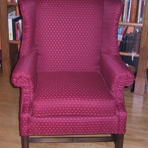 Similar fabric sharpens up this delightful wing chair