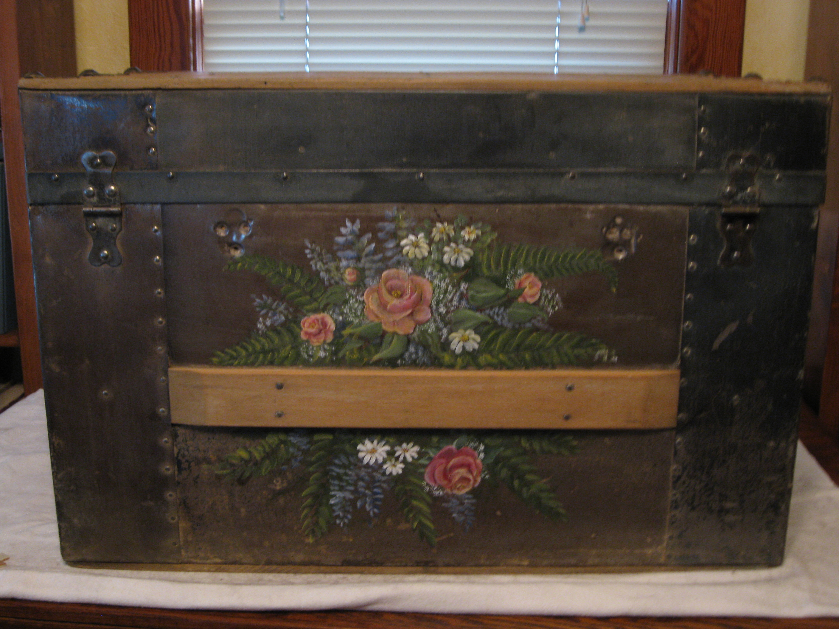 The client wanted an exuberant display of flowers sprayed across this old family trunk