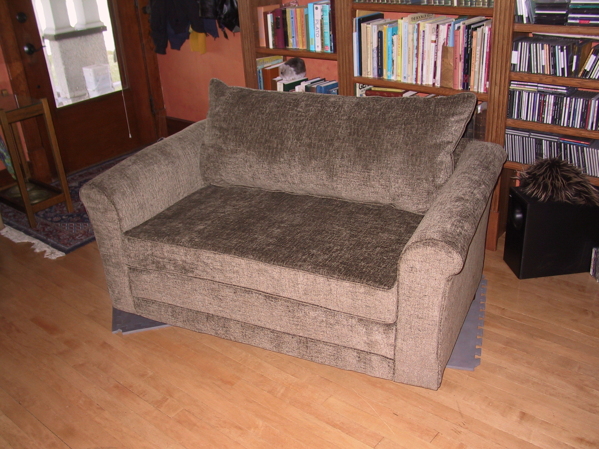 Smooth velvety fabric gives this loveseat a striking new look