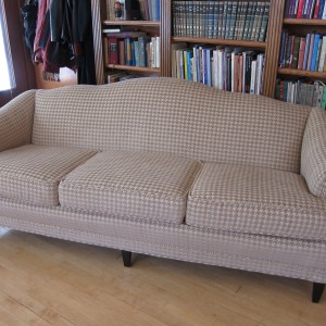 A bold houndstooth pattern and the removal of the skirt completely transform this sofa
