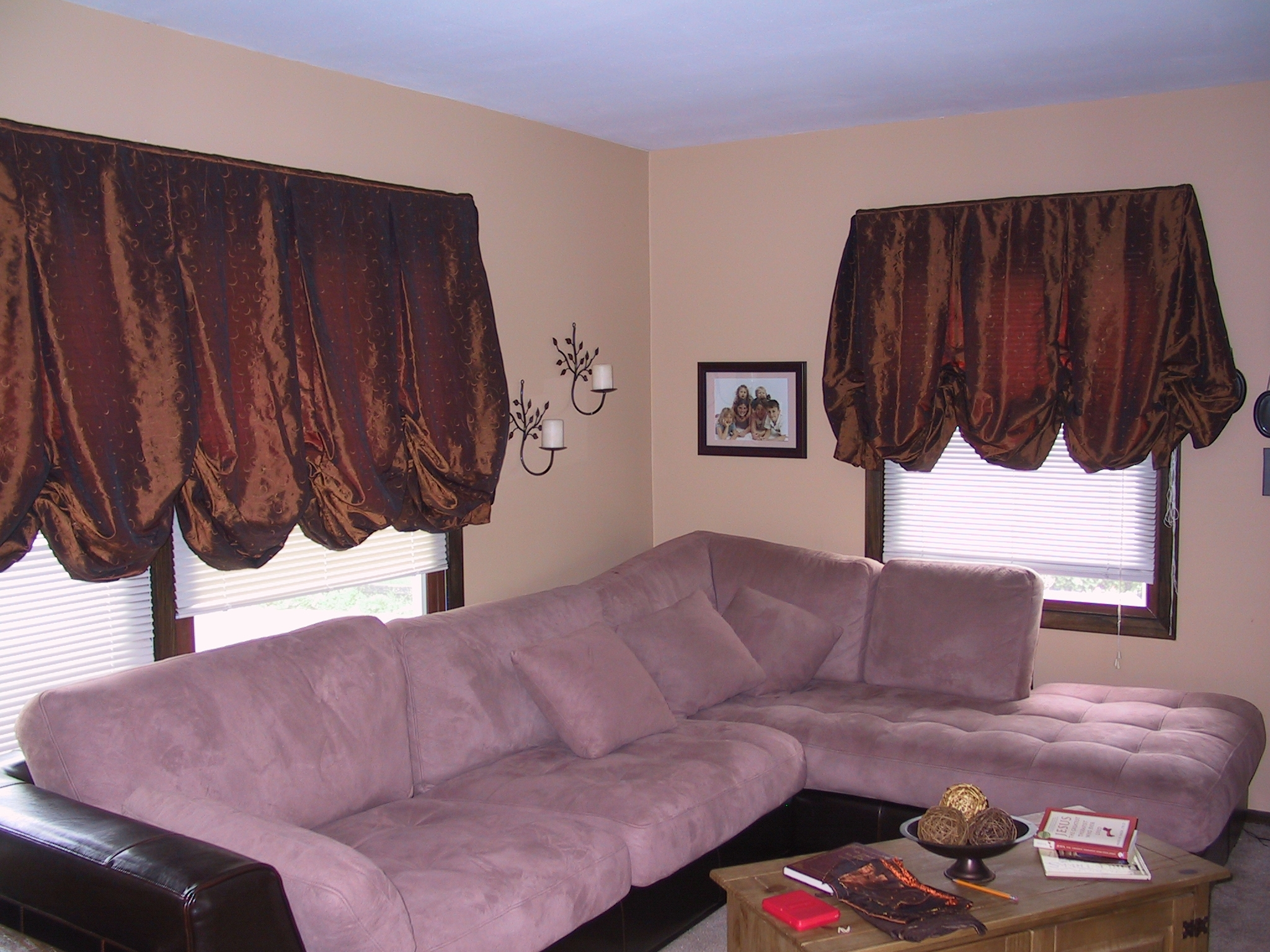 The client wanted simple, draped balloon curtains to soften the look of the room